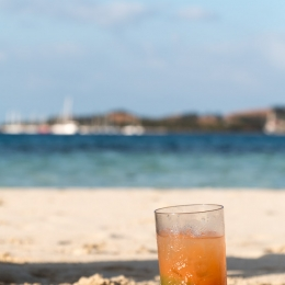 Life is really hard with a cocktail at a sand bar