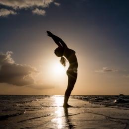 Yoga pose at the beach 2