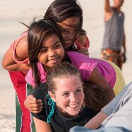 Laura (volunteer) with her 2 kids enjoying the beach